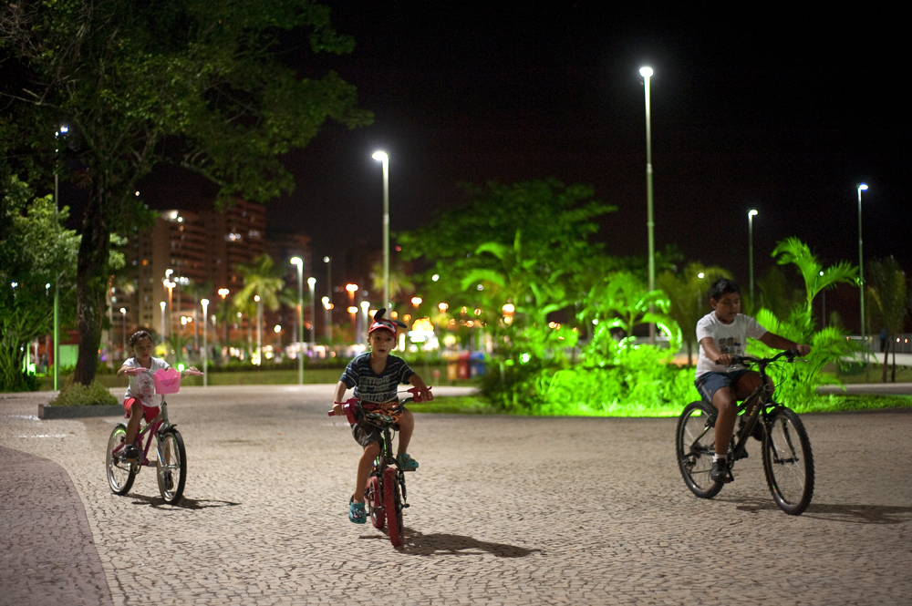 Children ride their bikes in a park in the upscale Ponta Negra neighborhood of Manuas on the banks of the Rio Negro, a tributary of the Amazon River on Friday, March 16, 2012.  Manaus, Brazil, is a city in Northern Brazil that is booming and expanding into its surrounding rain forest.