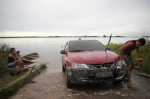 A man washes his car in the Amazon River outside of Manaus.