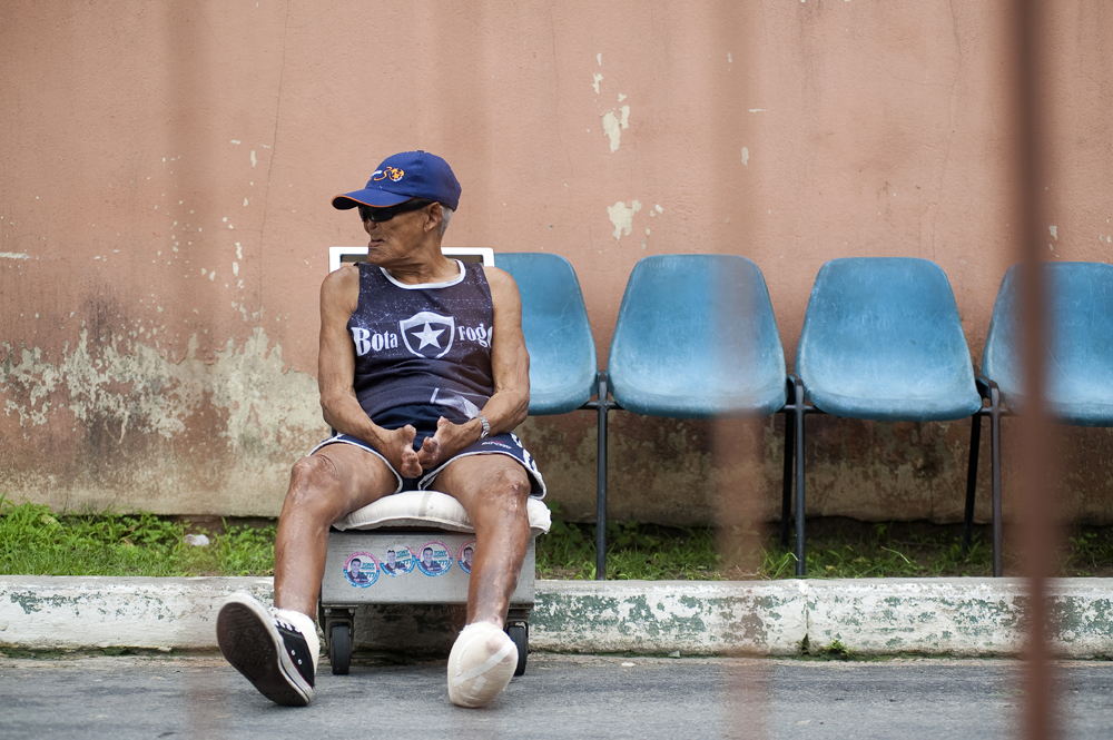 Milton Conraolo da Silva, 74, sits near the entrance of the leprosarium at Colonia Antonio Alexio in Manaus, Brazil on Saturday, March 17, 2012.  He was interned at the now defunct Paricatuba Leprosarium outside Manaus at the age of 13. In 1967, he came to live in Colonia Antonio Aleixo.