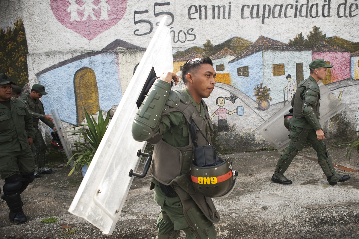 Soldiers carry riot gear near a voting center in the historically militant Chavista neighborhood 23 de Enero.
