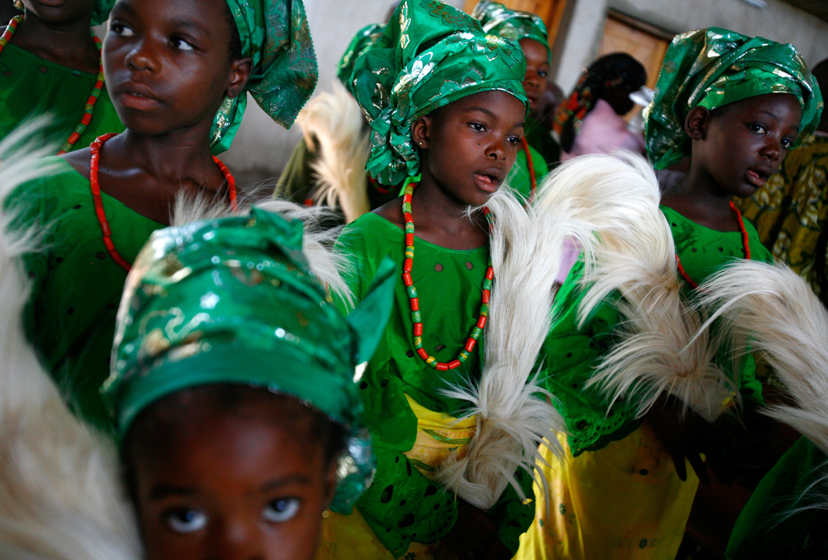 Young girls sing during church services in Urukpaleke where young Celestina once attended services with her family.
