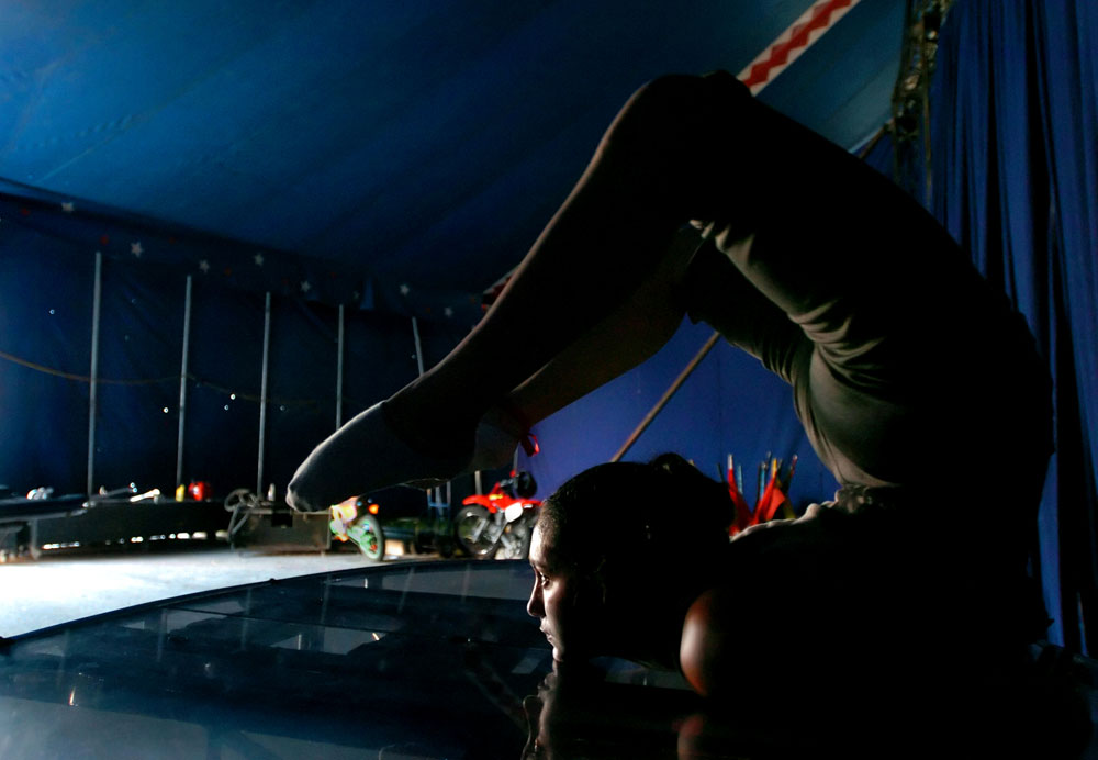 Stephanie Laurino, a 17-year-old contortionist from Argentina, prepares backstage for her performance Circo Hermanos Caballero in Dallas, Texas. She is a fifth generation circus performer.