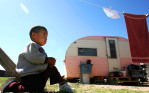 A two-year-old boy sits outside his great-grandmother's trailer in the colonia La Joya outside McAllen, Texas in 2007. Most of his extended family are without health care. Texas leads the nation in people without healthcare insurance and the border region has the highest number.