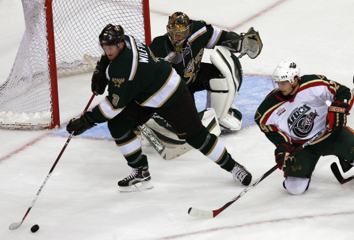 The Iowa Stars' Marty Wilford, left, takes control of the puck against the Houston Aeros # 29 Ben Thomson in the first period of Sunday's game at the Toyota Center in Houston Sunday October 8, 2006. The Stars won 6-3.