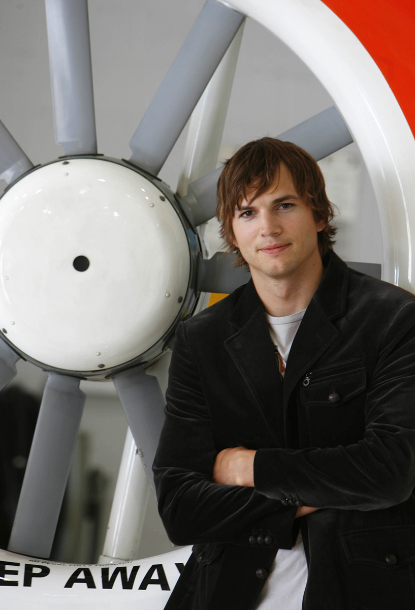Actor Ashton Kutcher poses at the United States Coast Guard at Ellington Field where he was promoting his new action-adventure movie  {quote}The Guardian{quote} on August 29, 2006.