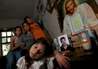 Stephanie Munoz, 3, sits Saturday March 18, 2006 by an altar  in her Palau house erected for her father who is trapped in the Pasta de Conchos coal mine in San Juan de Sabinas, Mexico. From left behind her is her sister Tanya Munoz, 13, her mother Elvira Martinez Espinoza and her brother Christian Munoz, 11. In the Early morning on Sunday February 19,2006 sixty-five miners were trapped as much as 2000 feet below ground after an explosion.Sharon Steinmann / Houston Chronicle