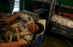 Alicia Pecina of Palau rests with a puppy her sisters gave her in a tent set up for families of trapped miners at the Pasta de Conchos coal mine in San Juan de Sabinas, Mexico Friday March 17, 2006. Her husband, Jorge de Hoyos Marquez is trapped in the mine. In the Early morning on Sunday February 19, sixty-five miners were trapped as much as 2000 feet below ground after an explosion.Sharon Steinmann / Houston Chronicle