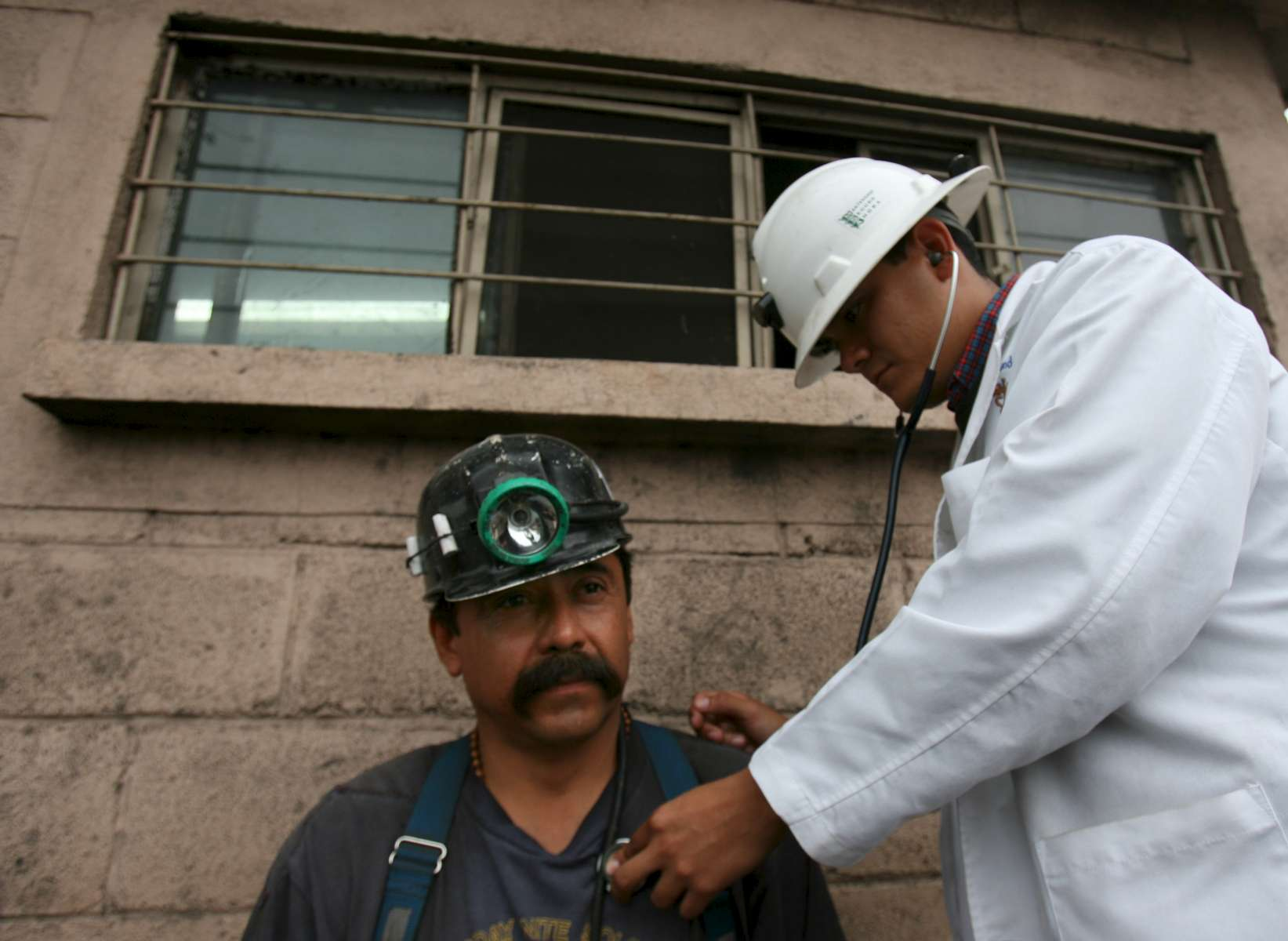 Rolando Javier Valero undergoes his morning medical exam with doctor Edmundo Mena of Torreon, Mexico (accent on {quote}o{quote}) at the Pasta de Conchos coal mine in San Juan de Sabinas, Mexico Friday March 17, 2006. His brother, Eliud Valero, is trapped in the mine. In the Early morning on Sunday February 19, 2006 sixty-five miners were trapped as much as 2000 feet below ground after an explosion.Sharon Steinmann / Houston Chronicle