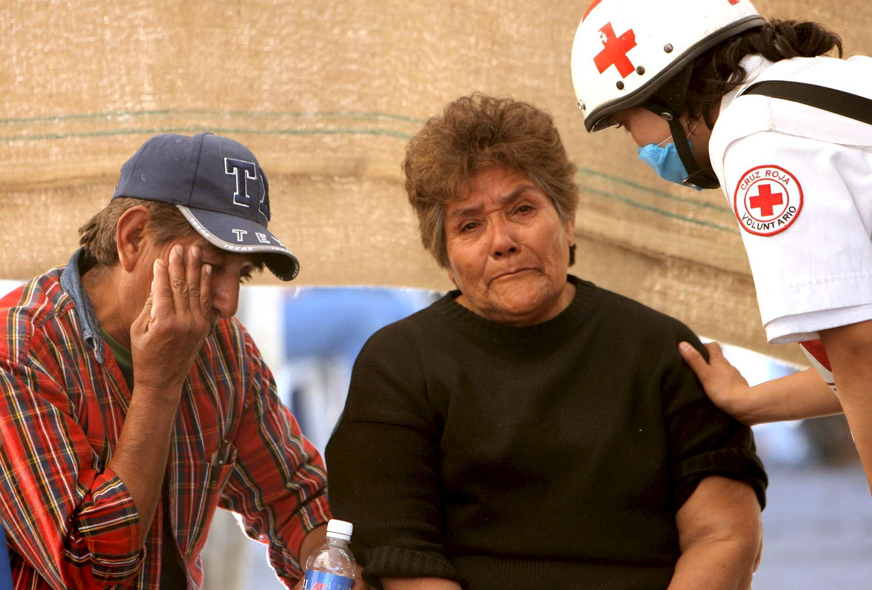 A red cross worker comforts Petra Arteaga Garcia, center, and her brother Miguel Arteaga Garcia after they received news Saturday that the explosion at the Pasta de Conchos coal mine in San Juan de Sabinas in the Mexican state of Coahuila created temperatures too high for survivors. Their brother, Juan Raul Arteaga, 46, was trapped in the mine.  In the Early morning on Sunday 65 miners were trapped as much as 2000 feet below ground after an explosion.Sharon Steinmann / Houston Chronicle