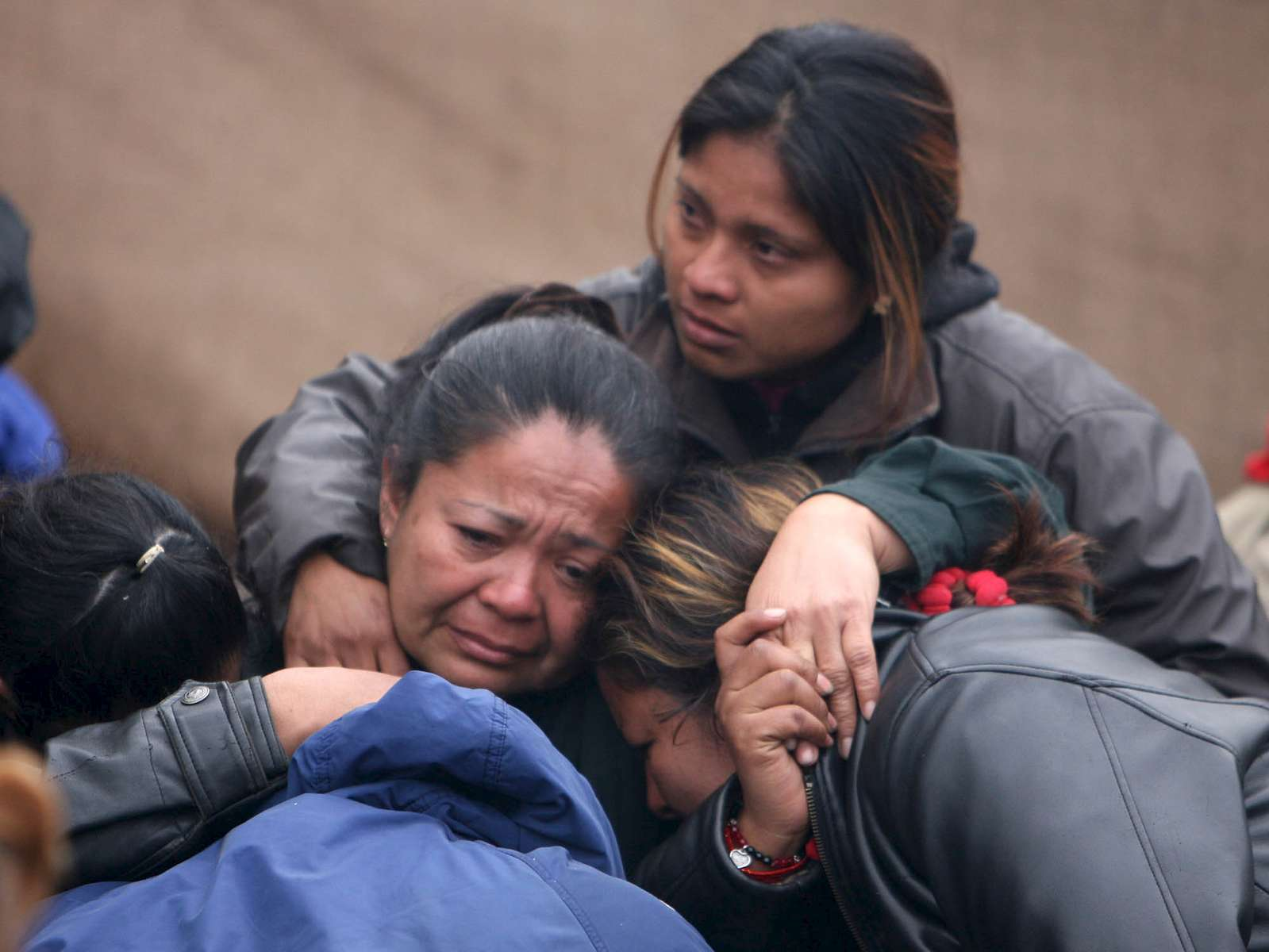 Family members mourn after a grim early morning press conference in front of the Pasta de Conchos coal mine in San Juan de Sabinas in the Mexican state of Coahuila Tuesday. Family members waited outside the Pasta de Conchos coal mine Tuesday. In the Early morning on Sunday 66 miners were trapped 163 meters below ground after an explosion.Sharón Steinmann / Houston Chronicle