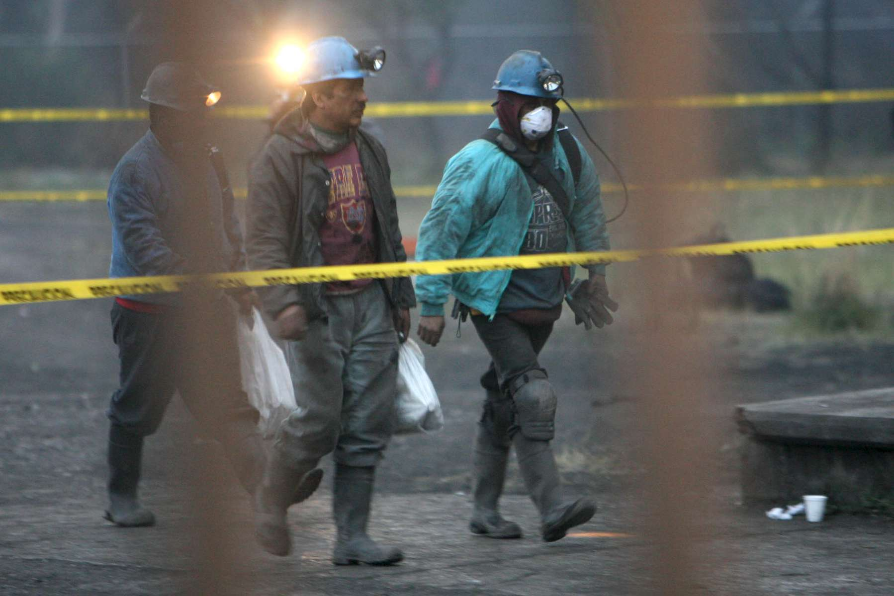 Miners walk outside of the Pasta de Conchos coal mine in San Juan de Sabinas in the Mexican state of Coahuila Tuesday. Family members waited outside the Pasta de Conchos coal mine Tuesday. In the Early morning on Sunday 66 miners were trapped 163 meters below ground after an explosion.Sharón Steinmann / Houston Chronicle