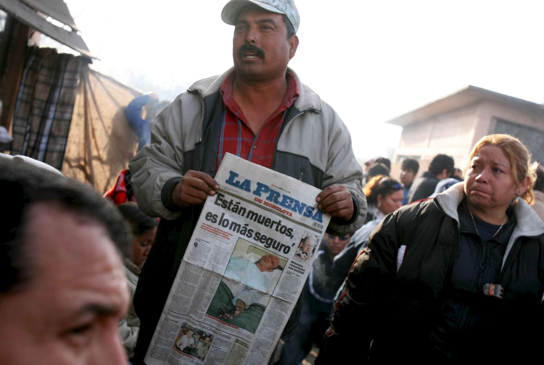 A distraught man holds up a Mexican paper with a headline that reads {quote}They are dead, almost certainly{quote} in front of the Pasta de Conchos coal mine in San Juan de Sabinas in the Mexican state of Coahuila Wednesday. Family members became increasingly frustrated as they waited outside the Pasta de Conchos coal mine Wednesday. In the Early morning on Sunday 65 miners were trapped as much as 2000 feet below ground after an explosion.Sharon Steinmann / Houston Chronicle