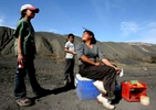 From left, Rosa Estela Rios, 13, Oscar Javier Rios, 12, and Dahlia Ruiz, 18, sell sodas and snacks to coal workers in front of coal refuse which are adjacent to their home in the Mexican town Palaú ( accent on {quote}U{quote} ) in the Mexican state of Coahuila Wednesday. Sharon Steinmann / Houston Chronicle