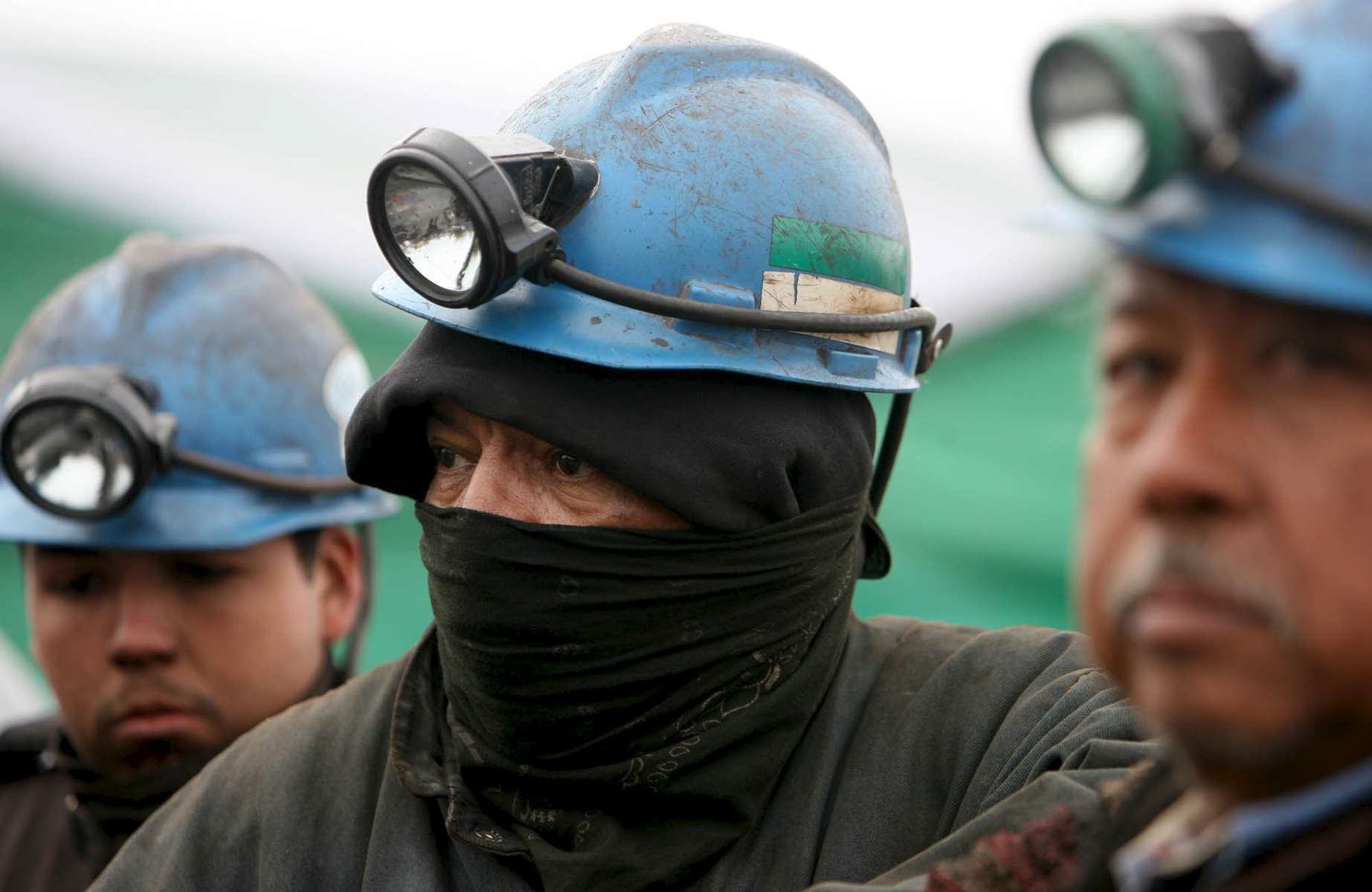 Weary miners, from left, Luis Enrique Beltrán, Rolando Sanchez, and Nicanor Limón, wait to start their shifts in rescue efforts in front of the Pasta de Conchos coal mine in San Juan de Sabinas in the Mexican state of Coahuila Tuesday. Family members waited outside the Pasta de Conchos coal mine Tuesday. In the Early morning on Sunday 65 miners were trapped 163 meters below ground after an explosion.Sharón Steinmann / Houston Chronicle