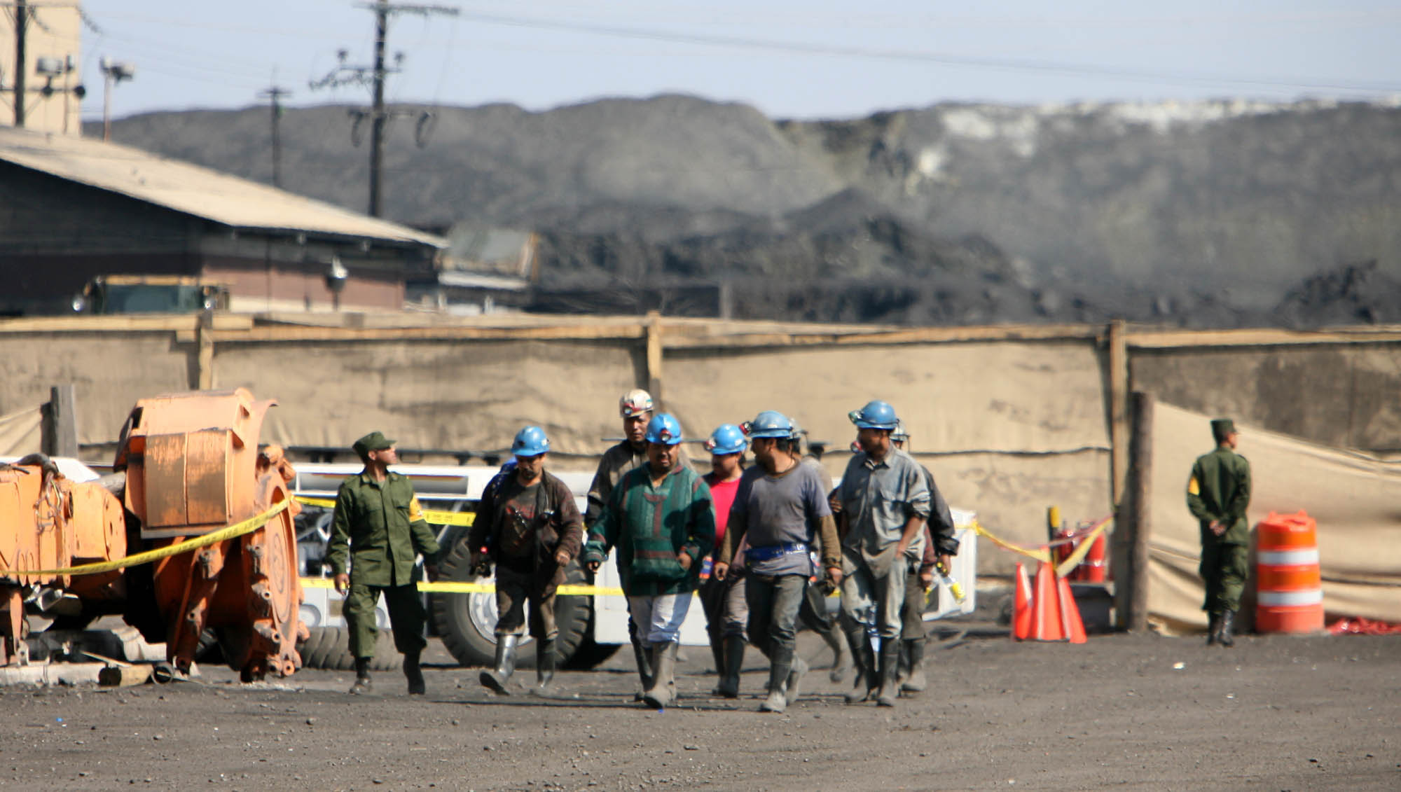 The scene in front of the Pasta de Conchos coal mine in San Juan de Sabinas in the Mexican state of Coahuila Tuesday where workers put up a cloth barricade Tuesday morning in front of the entrance to the mine. Family members waited outside the Pasta de Conchos coal mine Tuesday. In the Early morning on Sunday 65 miners were trapped 163 meters below ground after an explosion.Sharón Steinmann / Houston Chronicle