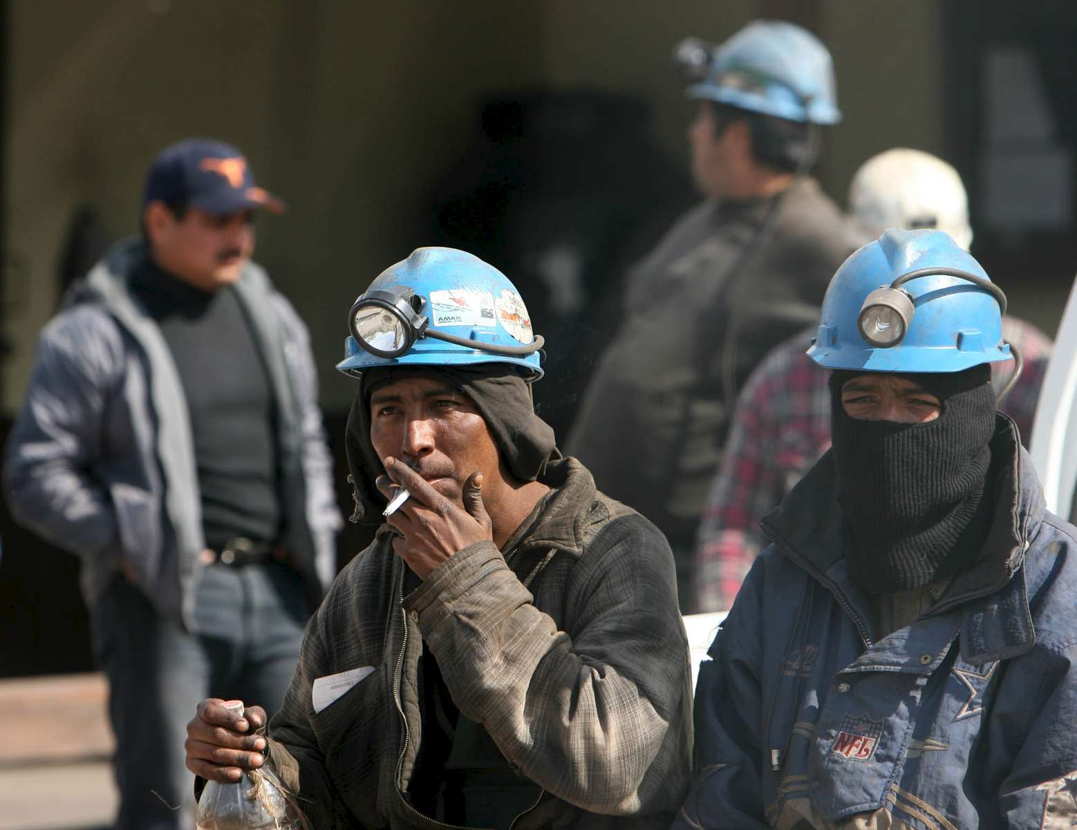 Miners wait outside the Pasta de Conchos coal mine in San Juan de Sabinas in the Mexican state of Coahuila Monday. In the Early morning on Sunday 66 miners were trapped 163 meters below ground after an explosion.Sharon Steinmann / Houston Chronicle