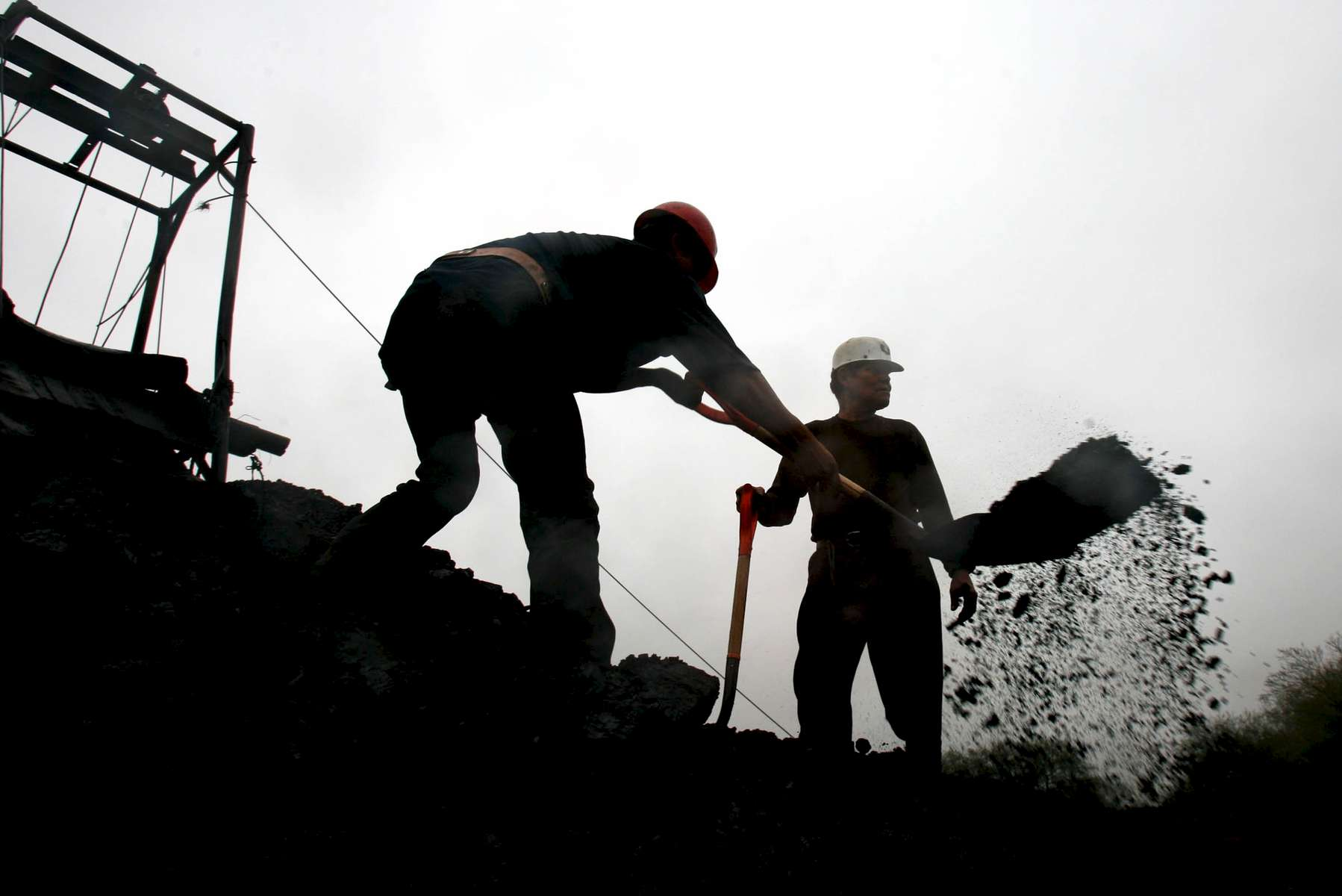 Coal miners work Friday at a coal mine owned by a different company than the one involved in Mexico's latest incident, about 10 kilometers from the Pasta de Conchos coal mine in San Juan de Sabinas in the Mexican state of Coahuila. Coal mines dot the landscape in the region. On Sunday 65 miners were trapped as much as 2000 feet below ground after an explosion.Sharón Steinmann / Houston Chronicle