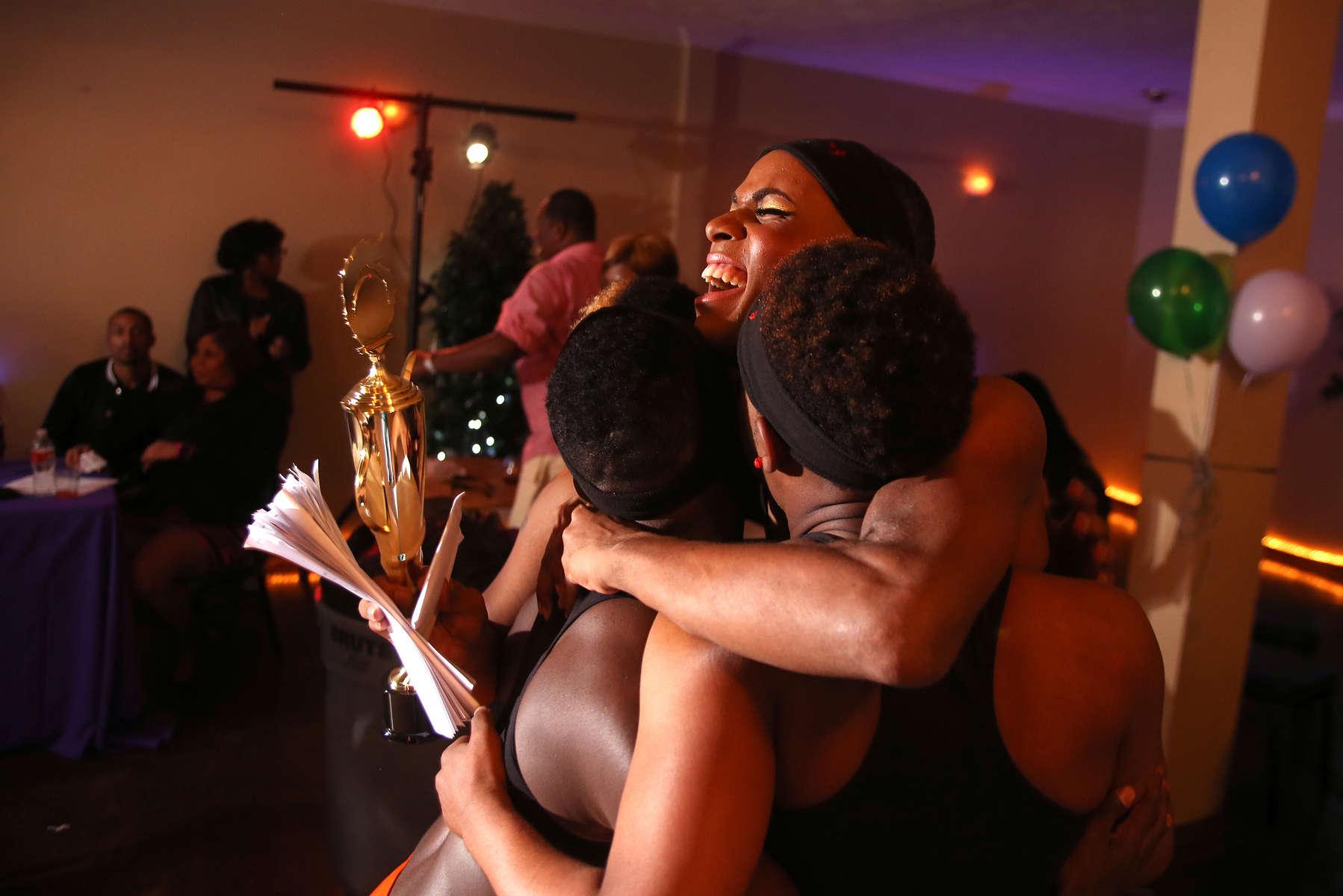 The Prancing Elites celebrate winning a J-setting competition during black gay pride week in Jackson, Miss.