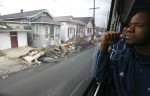 Linebacker Marcus Rucker looked at the destruction in the Ninth Ward of New Orleans on Wednesday December 20, 2006 during a bus tour of the devastation. The team was in town to play against Troy University in the R+L Carriers New Orleans Bowl.