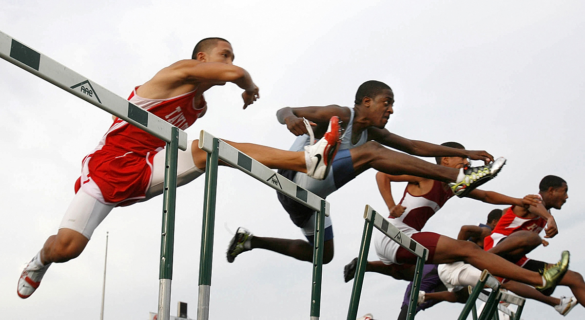 Second from left, David Vese of Elsik Hiigh School hurdles his way to second place in the boys 110 Meter Hurdles Wednesday during the District 19-5A running finals at LeRoy  Crump Stadium April 12, 2006 in Houston. At far left is Jimmy Houng of Taylor who finished in 5th place.