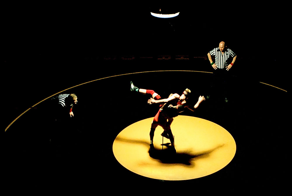 Daryl Gardner of Ferris High School in Spokane, WA overtakes his opponent Andrew Smith of University High School in Spokane during region IV wrestling championships at Southridge High School in Kennewick, WA.