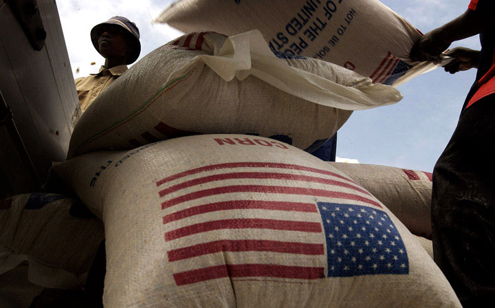 Dock workers in Maputo, Mozambique load bags of corn donated by the U.S. for distribution throughout southern Africa.