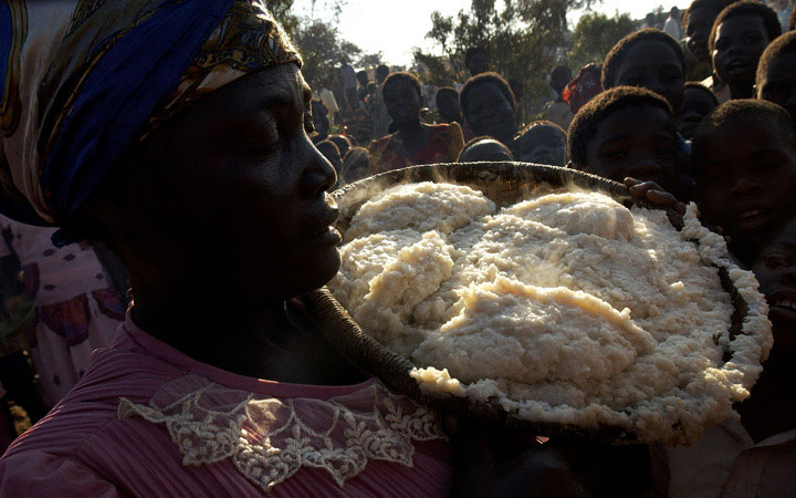 A steaming pile of nsima (cornmeal) is brought to a table during a wedding ceremony. Food insecurity in southern Africa is a perennial problem but food aid often helps alleviate the worst effects.