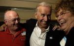 Biden laughs with Jerry Smith and Dixie Smith as they talk outside the conference hall where he addressed the Bremer County Democrats Summer Fundraiser in Waverly, Iowa. Biden is a hands-on politician who enjoys pressing the flesh to try and win support.