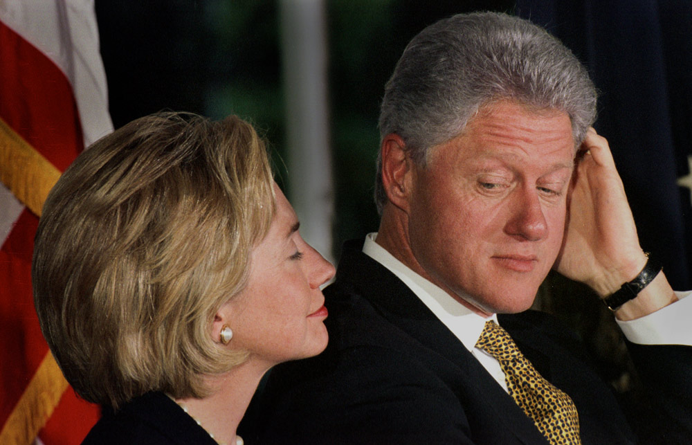 President Bill Clinton glances at his wife, Hillary, during their first public event since the release of the Starr Report giving explicit details about the president's {quote}activities{quote} with Monica Lewinsky.