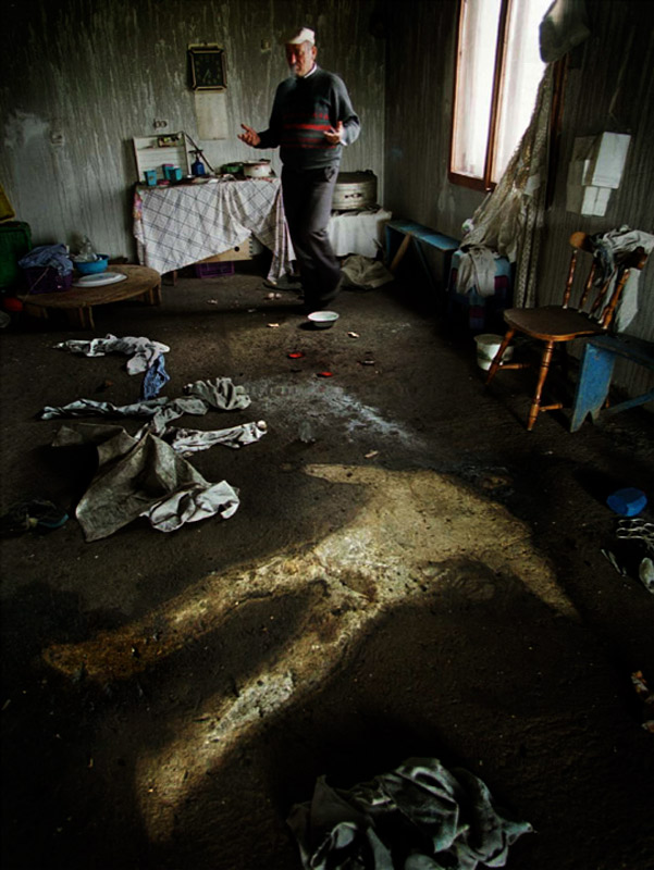 The silhouette of an executed Kosovar is all that remains on the floor of his home.