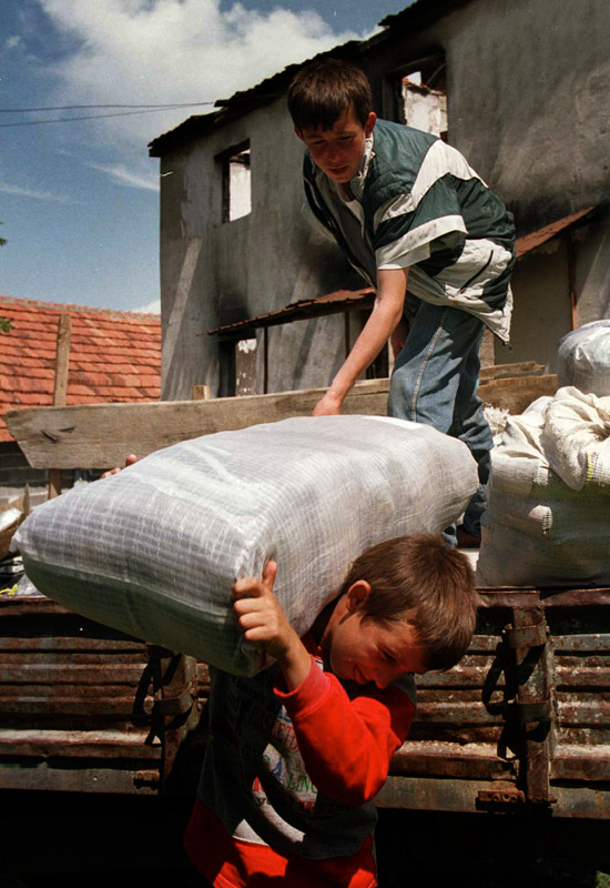 Food is offloaded and stored after a familiy returned home to Kosovo.
