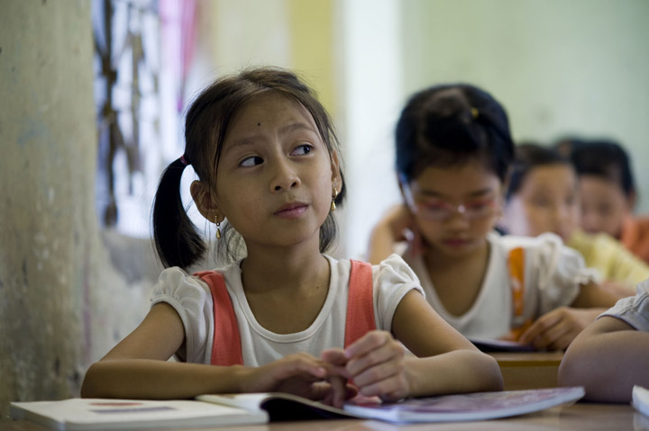Dao Thi Huong pays close attention to her teacher at school in Ke Sat, Vietnam. The young girl's family is one of 30 chosen for a new house as part of Habitat for Humanity International's 2009 Jimmy and Rosylnn Carter Work Project.