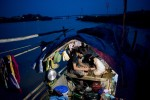 After the sun goes down the only source of light on Dao Thi Huong's boat is a single bulb. The family eats and sleeps on the 70 square foot boat. Huong lives with her grandparents to be able to go to school. Huong's family has been fishing for generations but she hopes to break the cycle with education and a new home being built as part of Habitat for Humanity International's 2009 Jimmy and Roslynn Carter Work Project.