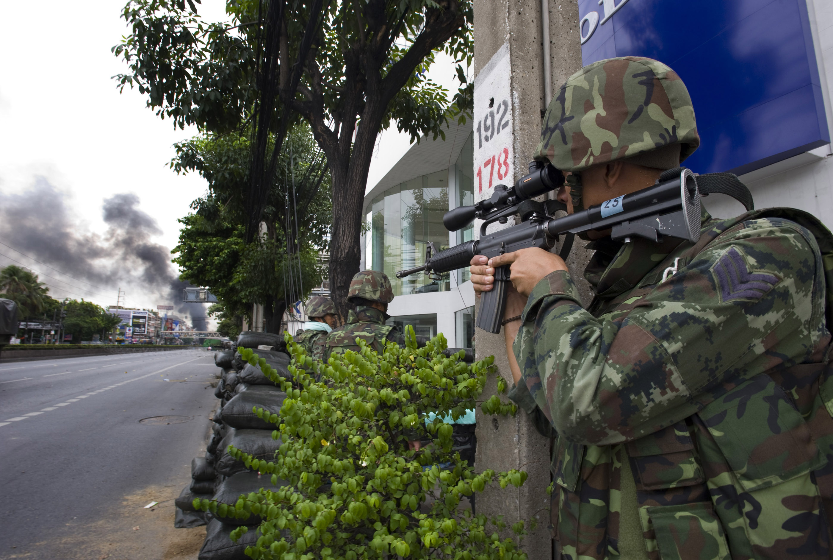The military takes up a position near one of the protesters barricades. Sporadic gunfire was heard during the day.