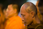 Monks pray while visiting the protest site.
