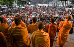 Buddhist monks pray with Red Shirt protesters at their main stage area in the heart of Bangkok.