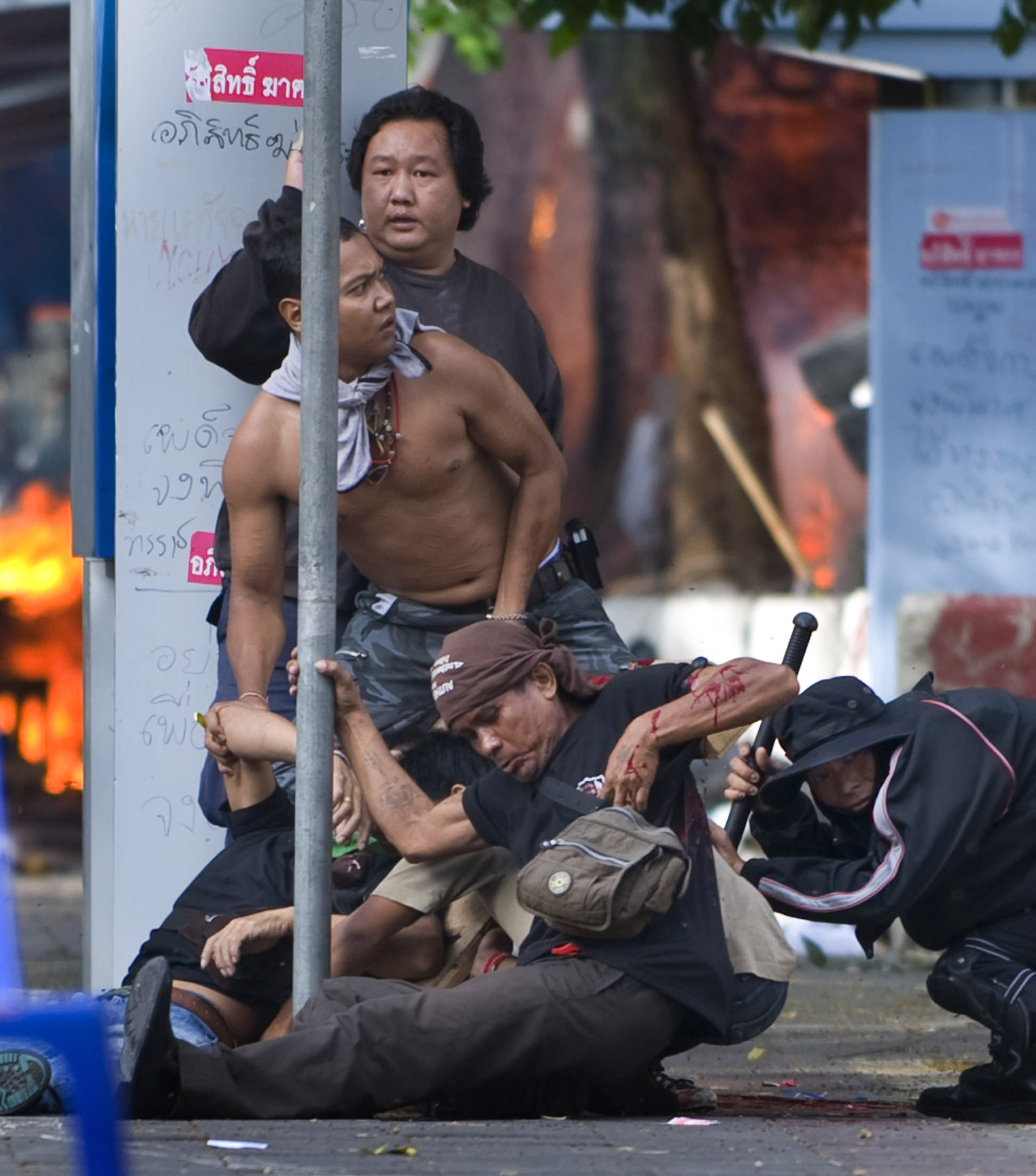 A unarmed man falls after being shot while trying to help his comrades collect a wounded Red Shirt protester. More than 80 civilians were killed during the three-month span.