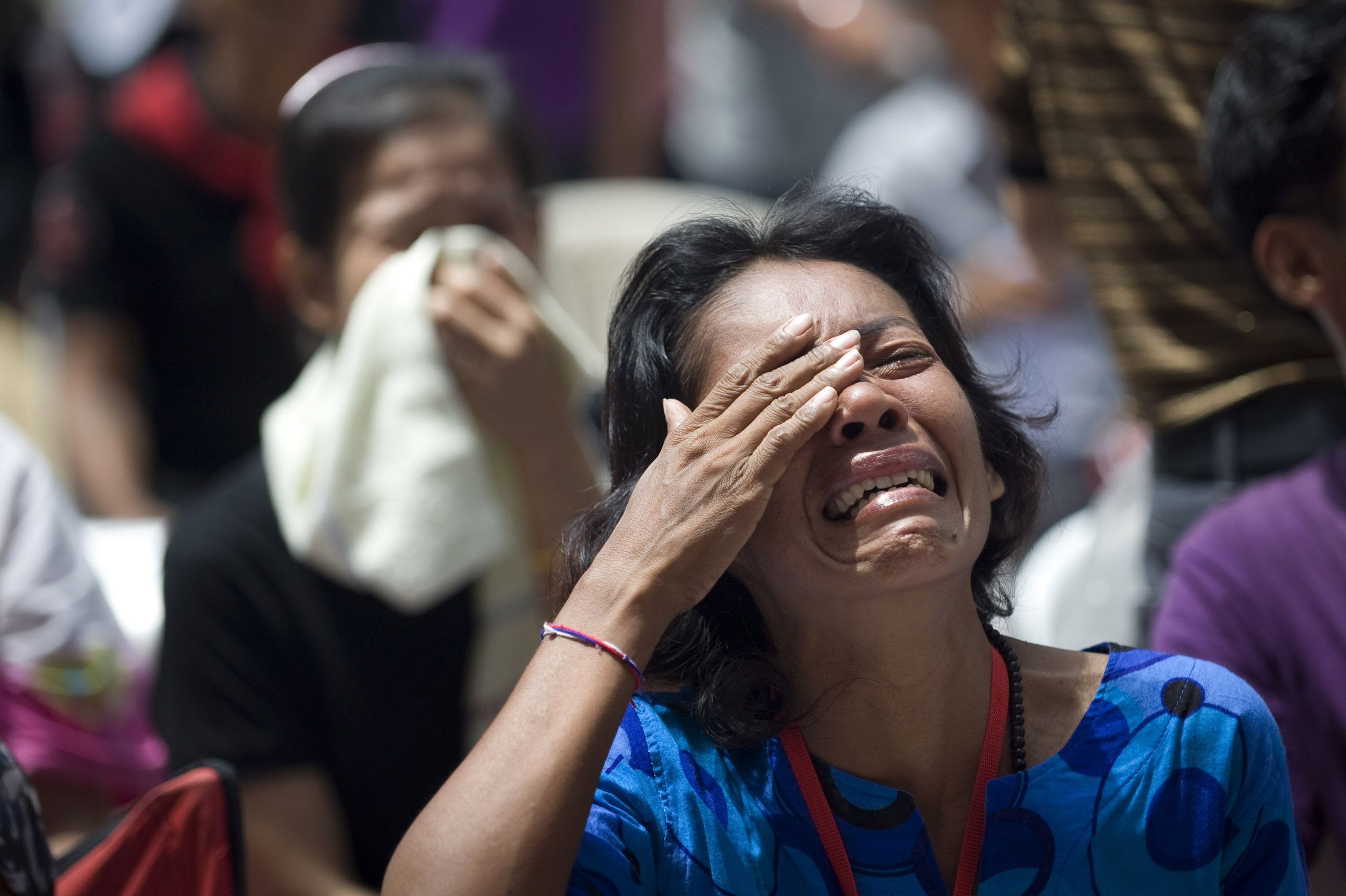 A Red Shirt supporter weeps as her leaders tell her to abandon the protest location they had occupied for nearly two months. The military was approaching the location quickly when the leaders made their announcement.