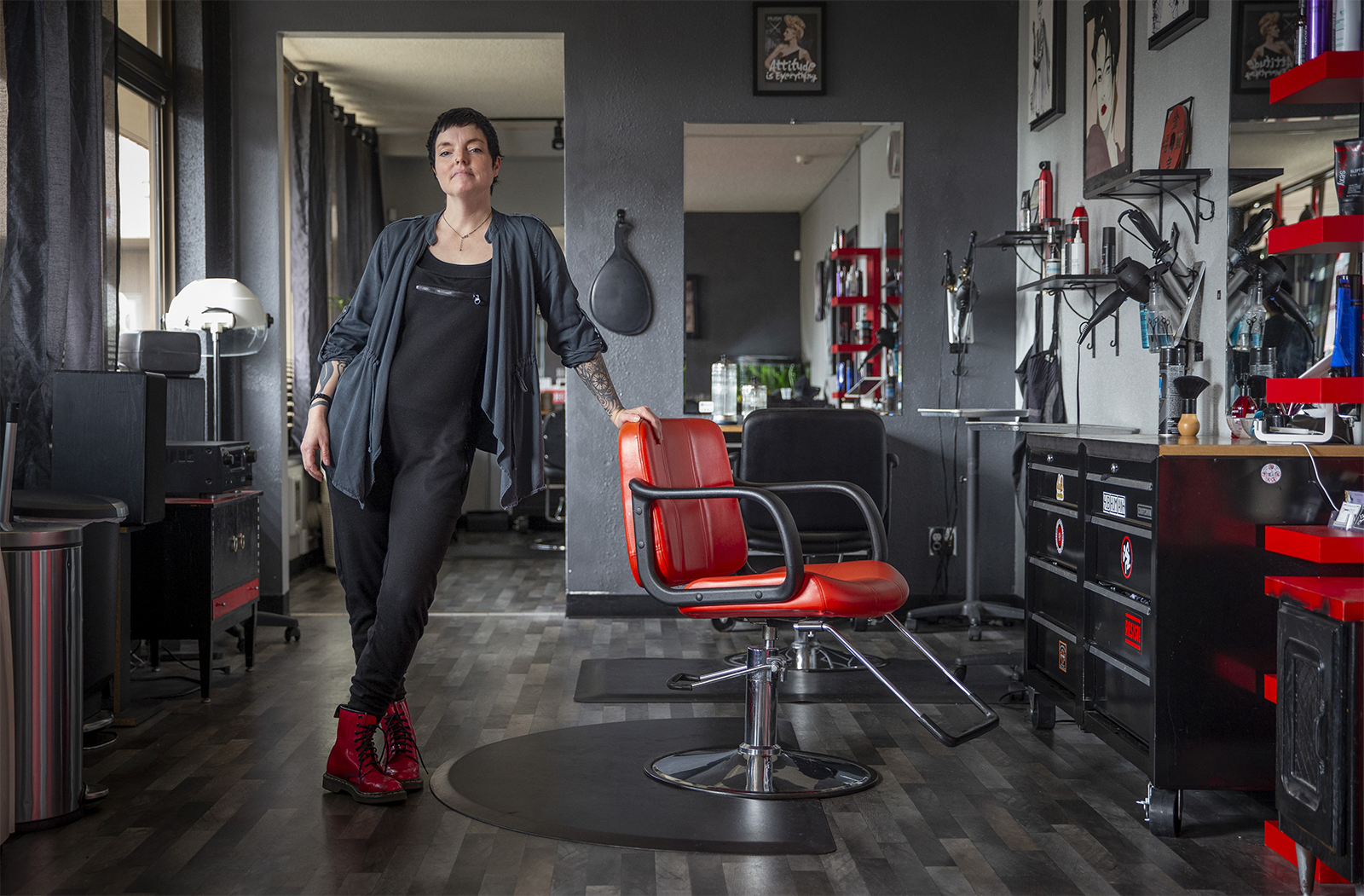 Cristina Stone, owner of 4th Dimension Salon, has closed her shop and has seen her income vanish along with all the stylists who rented space in the shop.