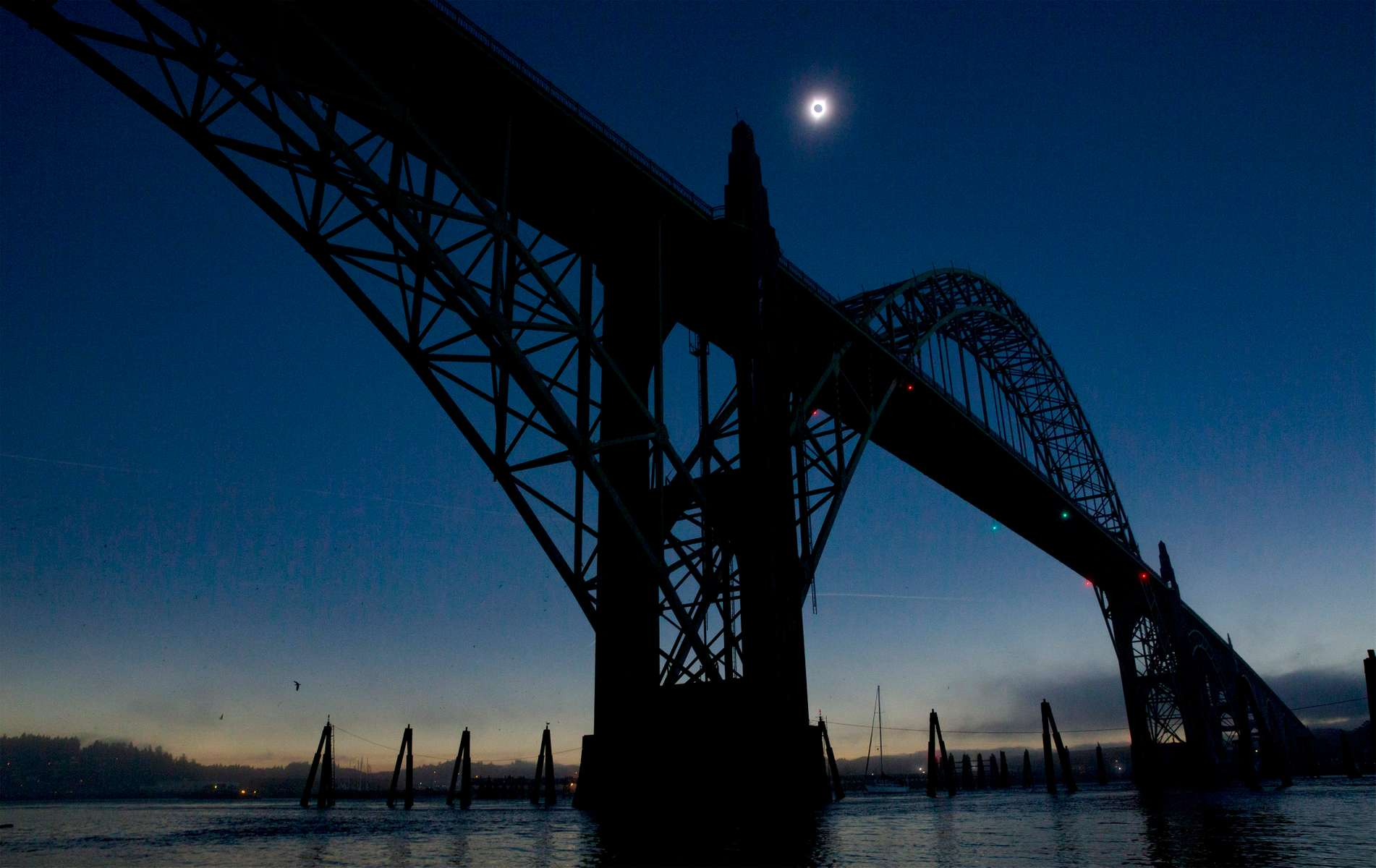 The sun reaches totality over the Yaquina Bay Bridge in Newport, Oregon on August, 21, 2017.