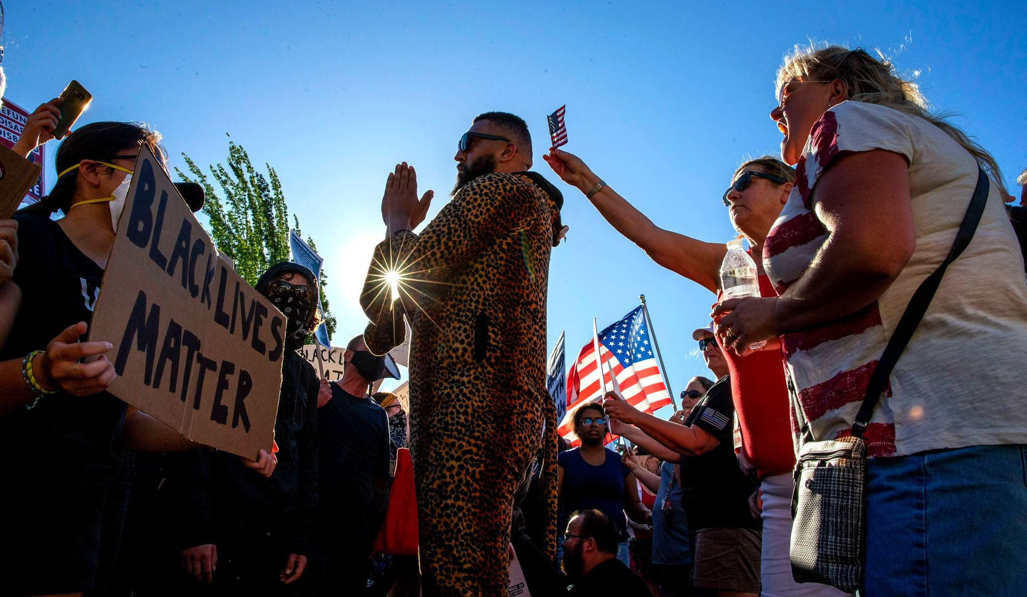 Isiah Wagoner works to keep the peace between pro-police demonstrators and a counterprotester at Springfield City Hall in Springfield, Oregon on June, 22, 2020.