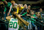 Young fans high five Oregon's Sabrina Ionescu as she leaves the court after leading the Ducks to a 76-64 win at Matthew Knight Arena.