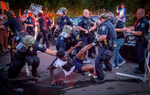 Tyshawn Ford, a leader of Black Unity, is dragged away by Springfield Police Wednesday at a barricade erected by police during a protest by the racial justice group in the Springfield, Ore. July 29, 2020. Ford was charged with disorderly conduct, interfering with police, and resisting arrest.