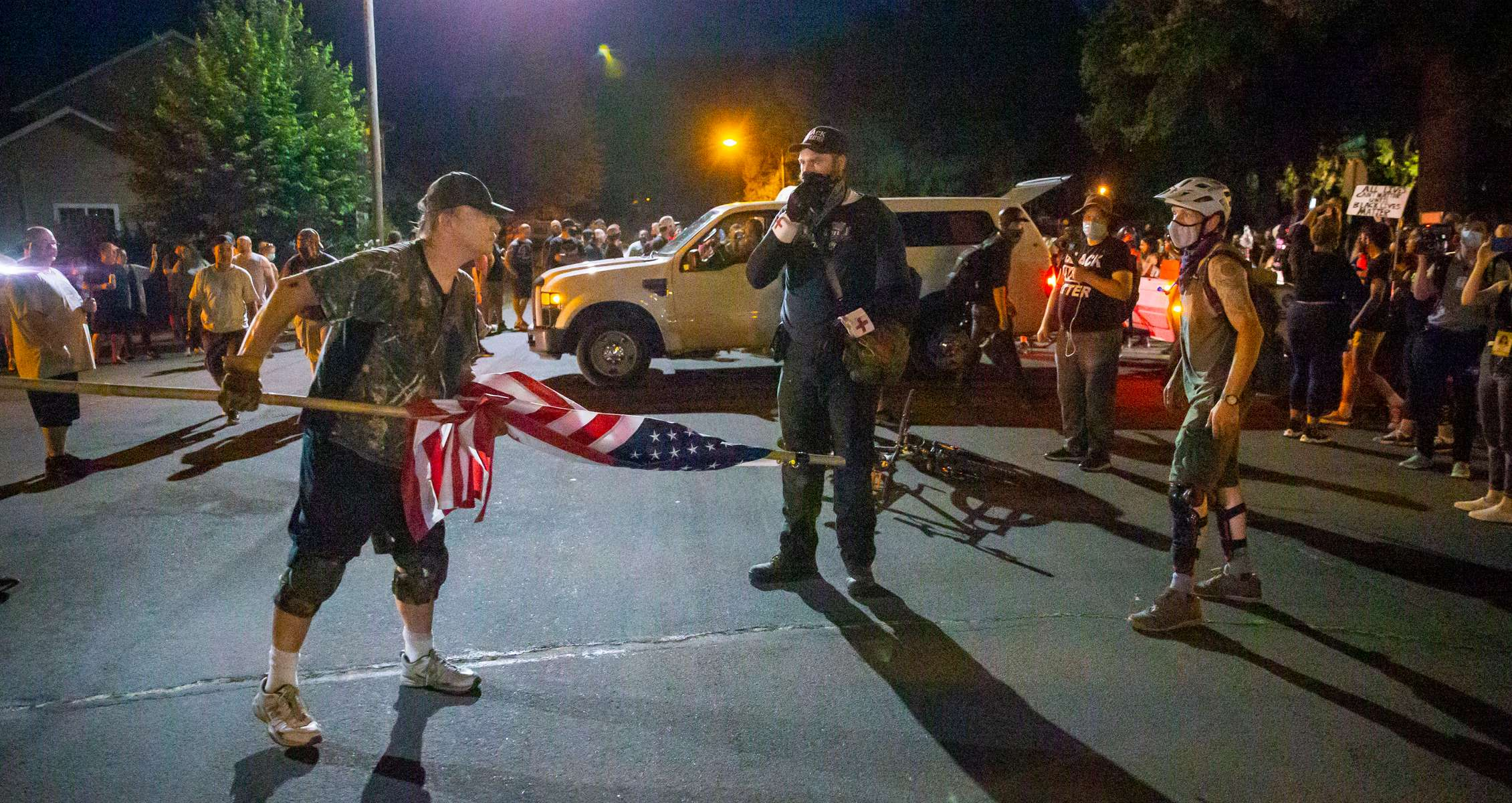 A counter-protester and a Black Unity protester square off as Black Unity protesters left the Springfield, Ore., neighborhood after marching through the streets in Springfield, Ore. July 29, 2020.