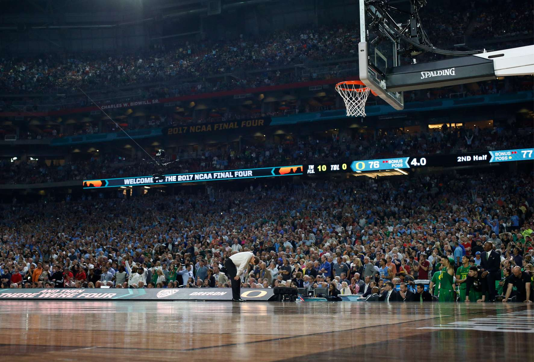 Oregon head coach Dana Altman bends in disappointment with 4 second left in the game against North Carolina in the 20198 NCAA National Semifinal at University of Phoenix Stadium in Glendale, Arizona.