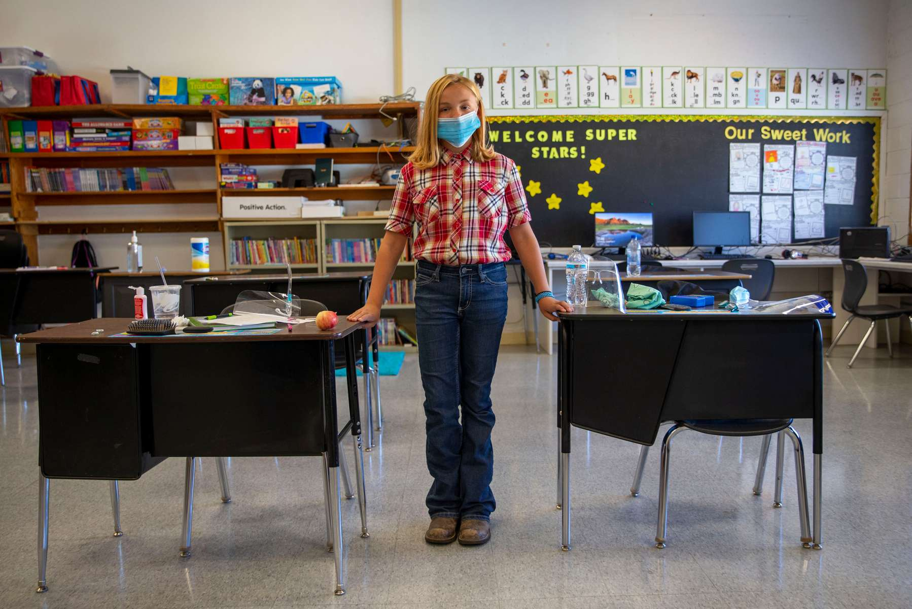 "Sixth grader Katie Newton in her classroom Sept. 2, 2020, in Spray, Oregon. Newton has been a Spray student her whole life. ""We actually get to go to school and, you know, we get to play outside and actually get to interact and stuff,"" Newton said."