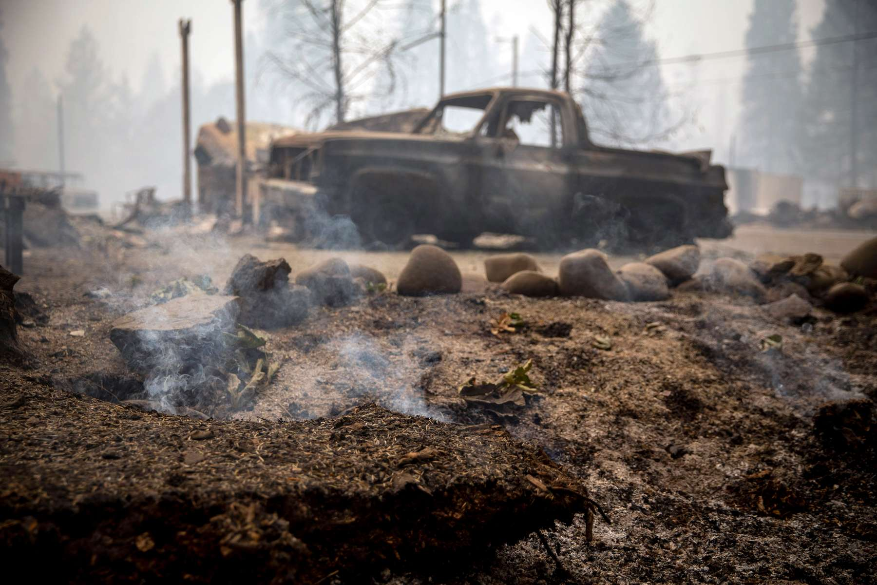 September 15, 2020: The ground still smokes in Blue River, Ore., Sept. 15, 2020 eight days after the Holiday Farm Fire swept through its business district. More than 300 structures have been confirmed destroyed in the fire. Mandatory Credit: Pool photo/Andy Nelson/The Register-Guard via USA TODAY NETWORK