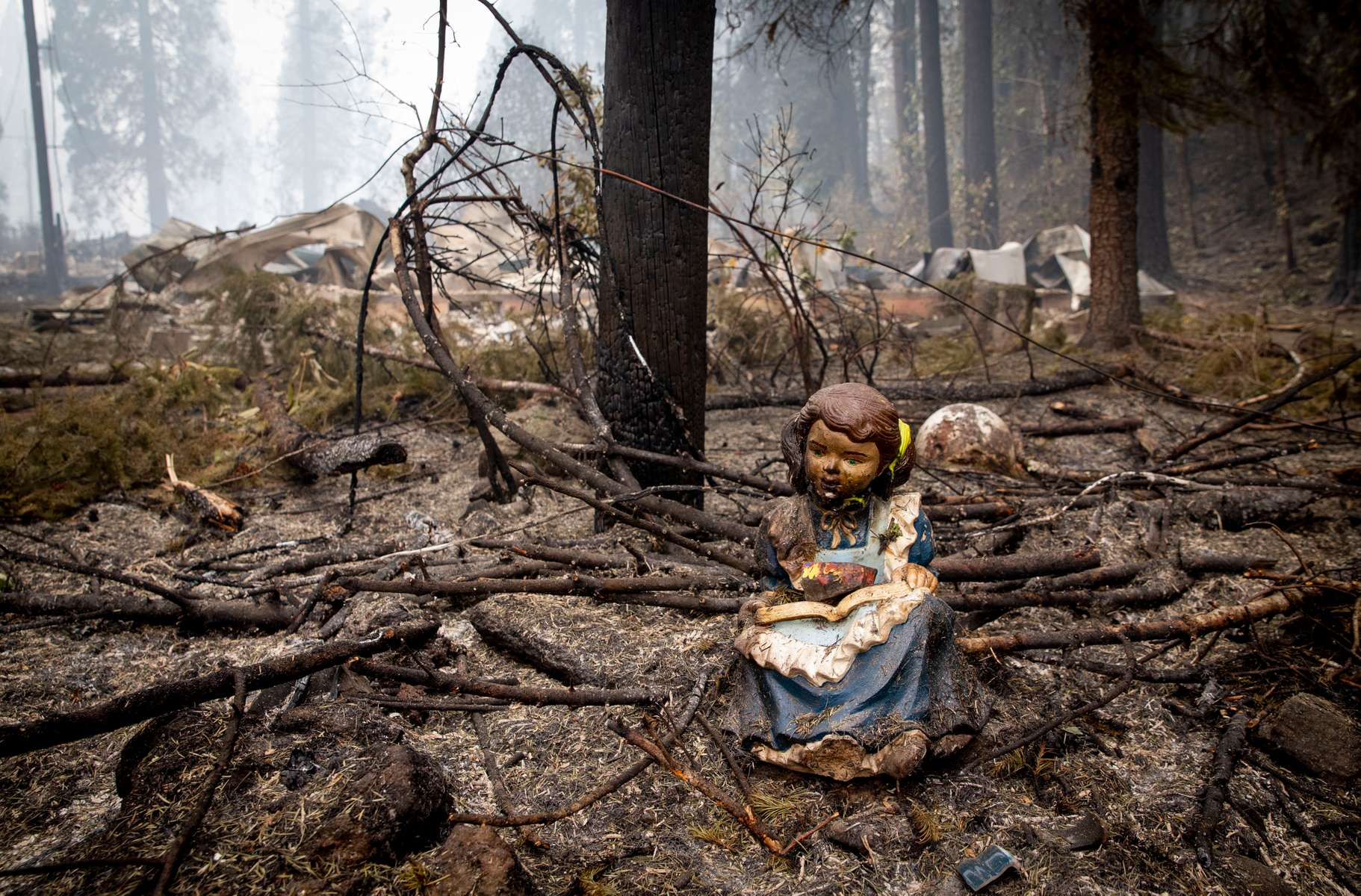 September 15, 2020: A statue of a girl reading sits Sept. 15, 2020, in Blue River, Oregon near where the library stood before it was destroyed in the Holiday Farm Fire. It has been eight days since the fire started near the small community on the McKenzie River. More than 300 structures have been confirmed destroyed in the fire.  Mandatory Credit: Pool photo/Andy Nelson/The Register-Guard via USA TODAY NETWORK