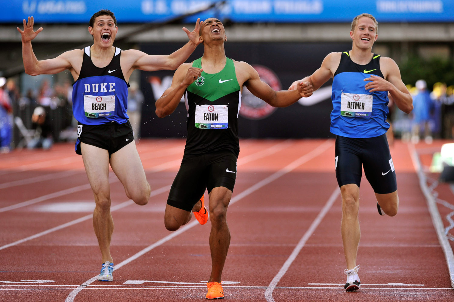 Ashton Eaton, flanked by Joe Detmer, right and Curtis Beach, hits the finish line at 4 minutes, 14.48 seconds in teh 1,500 meters to set a decathlon world record.