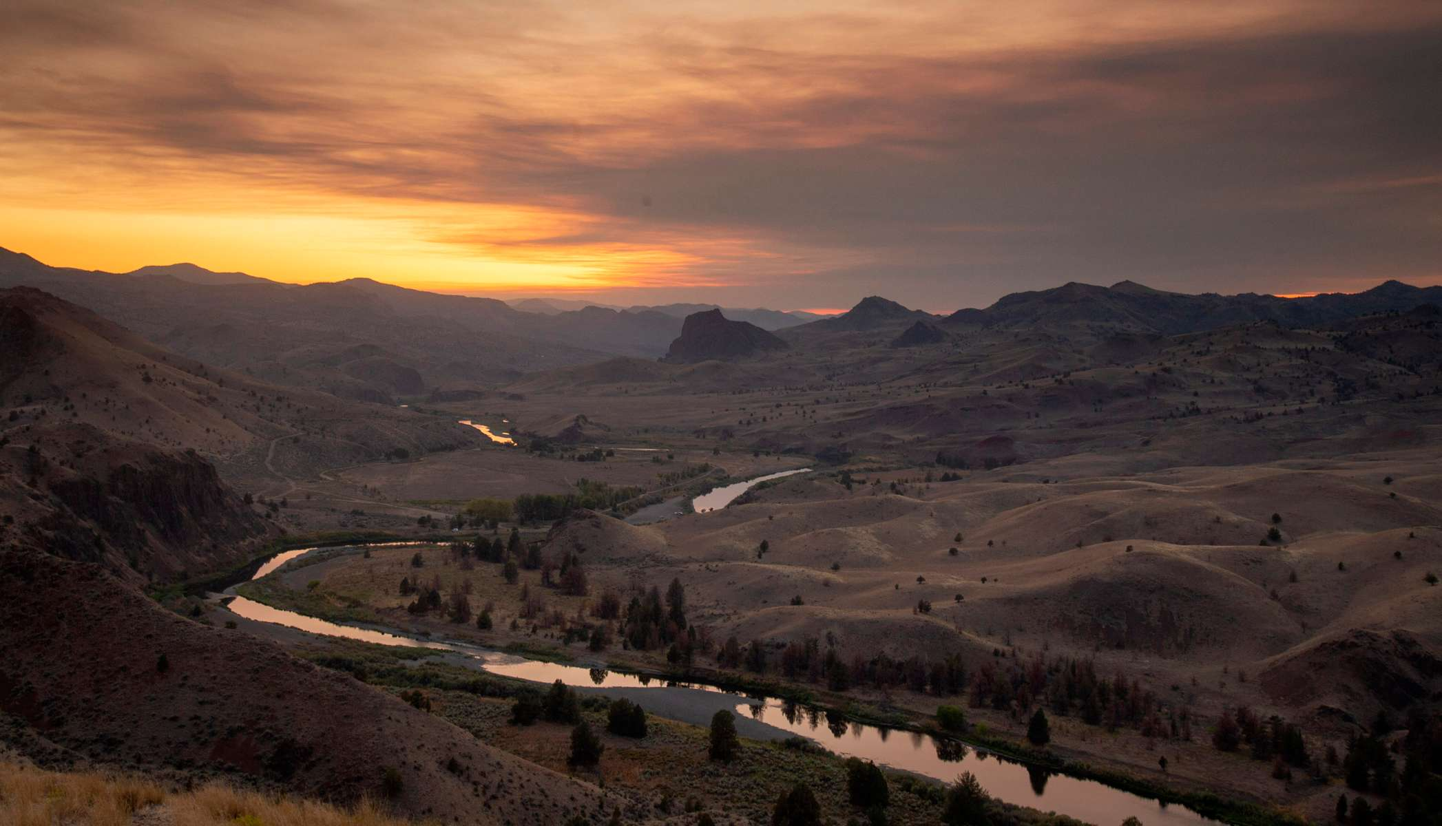 The John Day River courses through Wheeler County as the sun sets on Sept. 3, 2020, near Mitchell, Oregon. Wheeler County covers more than 1,700 square miles in north central Oregon and has a population of about 1,300 people. It is one of 10 counties in the United States that has yet to record a coronavirus case.